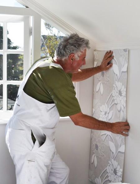 Bill hanging wallpaper
