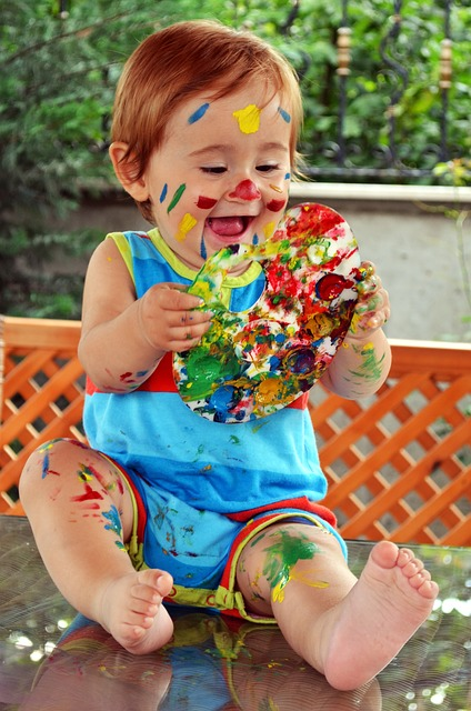 Baby playing with safe paint